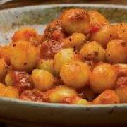 Potato dumpling with tomato sauce